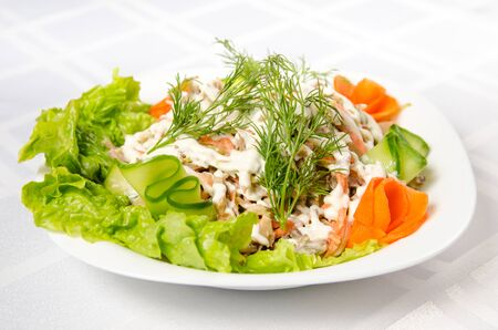 salad of boiled beef, champignons, carrots, pickled cucumbers, onions and lettuce seasoned with mayonnaise. Reklamní fotografie