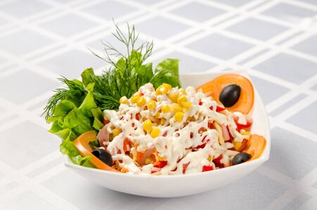 ham salad with corn, cheese, tomatoes, Bulgarian pepper, lettuce, green, olive and mayonnaise.