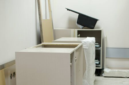 New open kitchen furniture prepared for assemble. installation of kitchen furniture.