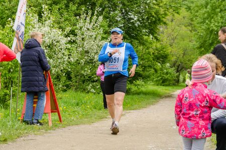 Komsomolsk-on-Amur, RUSSIA - JUNE 2, 2019. Running competitions among elderly sports veterans. female athlete finishes a distance in a running competition among senior athletes