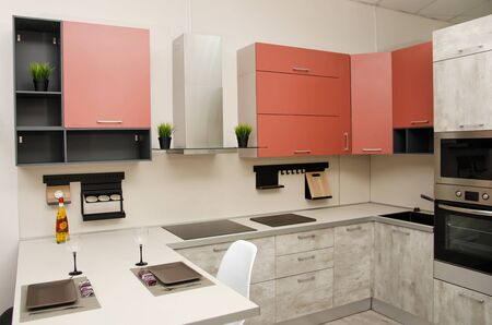 modern loft style kitchen with hob, fume hood and table with countertop. Banque d'images