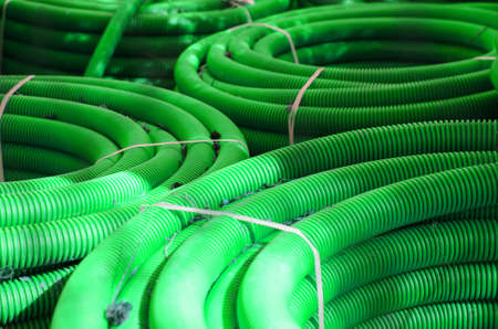many bundles of plastic water pipes green color.