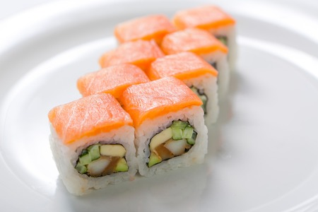 Rolls on the white plate. Japanese cuisine. Seafood