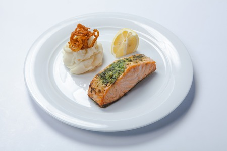 Salmon stake with mashed potatoes on the white plate Stock Photo