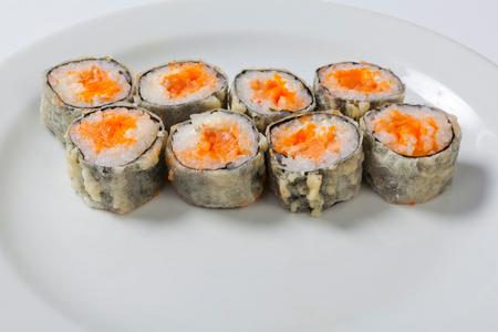 Tempura Rolls on the white plate. Japanese cuisine. Seafood Stock Photo
