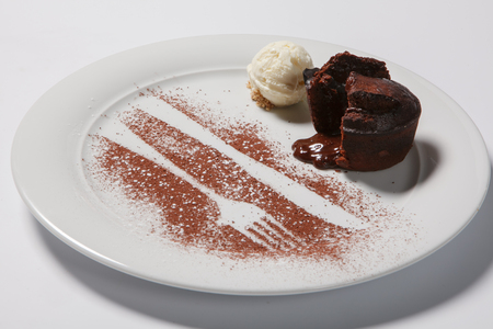 Lava cake with ice cream on a white plate. Isolated Stock Photo