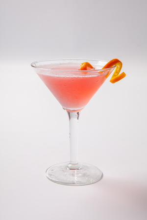 whithe: Red cocktail with orange garnish on a whithe background. Isolated Stock Photo