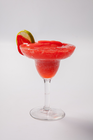 studioshot: Strawberry daiquiri with lime in a glass. Isolated