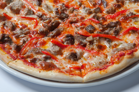 Homemade Meat Loves Pizza with Pepperoni Sausage and Bacon. White background