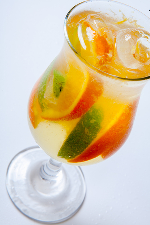 alcoholic cocktail with rum liqueur, orange lime and tequila. White background