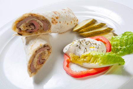filled roll: Rolls from pita bread stuffed with beef and onion decorated with vegetables.