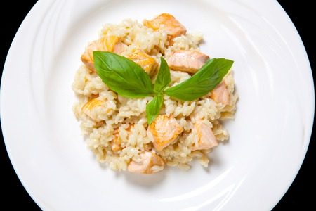 Risotto with salmon in a mild creamy sauce.