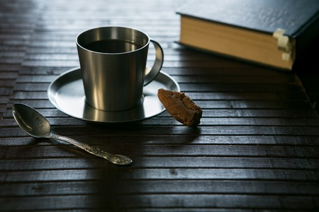 mocca: coffee Cup cookies and glasses on the book in the background. Stock Photo