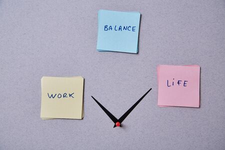 Work life balance choice concept. Clock arrows between stickers with inscriptions