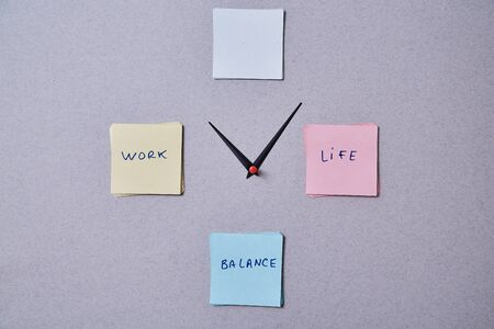 Work life balance choice concept. Clock arrows between stickers with inscriptions Imagens