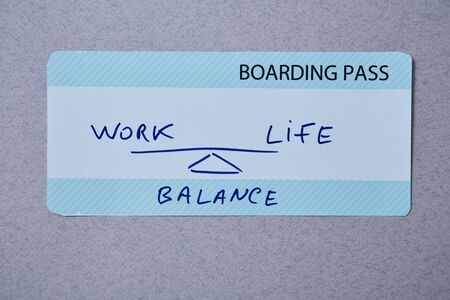 Work life balance choice concept. Boarding pass boarding pass on grey background Banco de Imagens