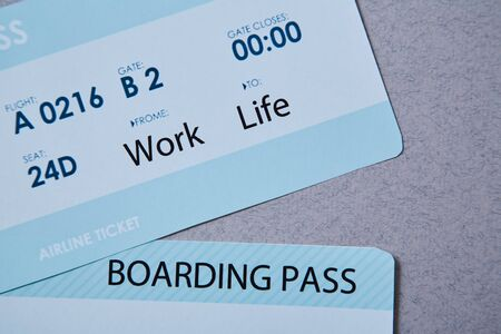 Work life balance choice concept. Boarding pass boarding pass on grey background Imagens