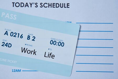 Work life balance choice concept. boarding pass on the schedule sheet.