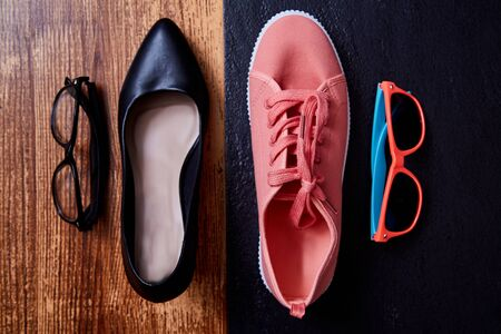 Work life balance choice concept: colored sneakers or sports shoes and strict office shoes Reklamní fotografie - 124678111