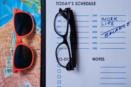 Work life balance choice concept: colored sunglasses and strict office glasses. Reklamní fotografie - 124678120