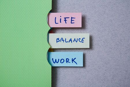 Work life balance choice concept. Stickers with inscriptions in a notebook Reklamní fotografie - 124678138