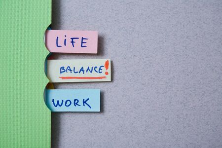 Work life balance choice concept. Stickers with inscriptions in a notebook Reklamní fotografie - 124678140