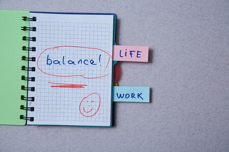 Work life balance choice concept. Stickers with inscriptions in a notebook