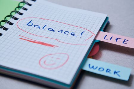 Work life balance choice concept. Stickers with inscriptions in a notebook Reklamní fotografie - 124678142