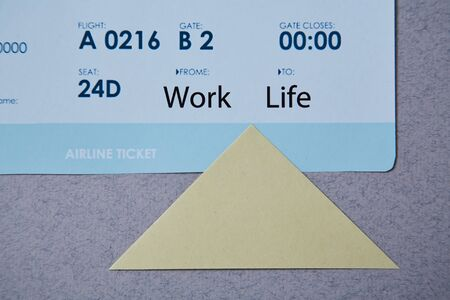 Work life balance choice concept. boarding pass and sticker.