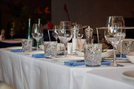 Table in the restaurant, served with wine glasses and ready to welcome guests.