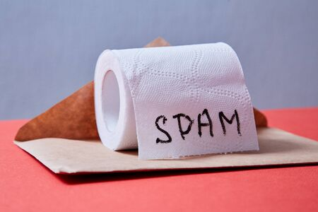 Junk mail or spam e-mail and unsolicited letter idea. A roll of toilet paper and envelope