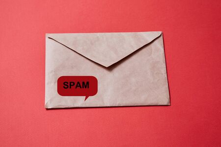Junk mail or spam and fake letter idea. Concept for unsolicited mail or e-mail. Envelope on red background