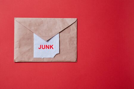 Junk mail or spam e-mail and unsolicited letter idea. Toilet paper sticking out of the envelope Stock Photo