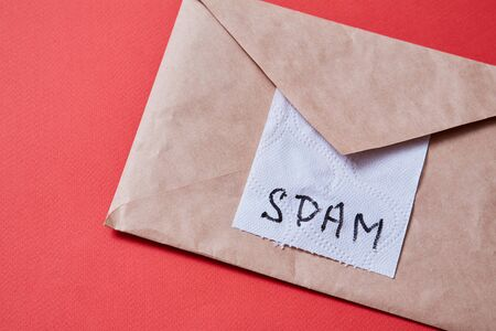 Junk mail or spam e-mail and unsolicited letter idea. Piece of toilet paper and envelope