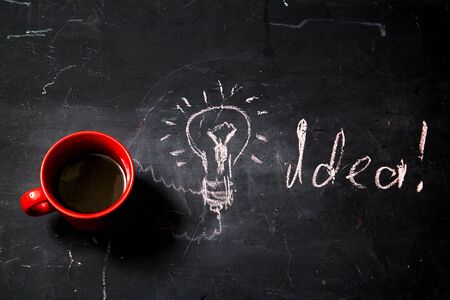Creative, bright idea and innovation or inspiration concept. Business solution. Cup of coffee and inscription Stok Fotoğraf