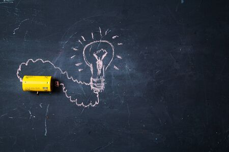 Creative, bright idea and innovation or inspiration concept. Business solution. Lamp pattern and battery. Stok Fotoğraf