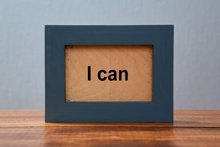 I can. Possible and impossible motivation. Concept for achievement and positive attitude: Photo frame with inscription.