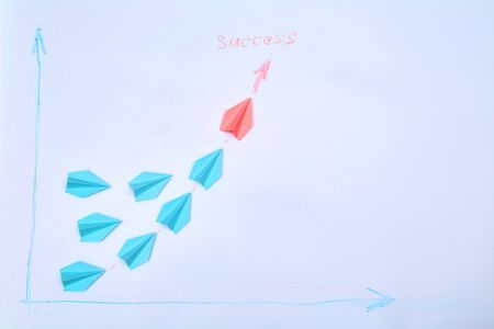Leadership, career and business competition concept: Red plane brings together a group of planes