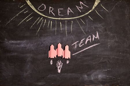 Unity and teamwork concept: Dream team, collaborate and cooperation. Three red rockets and the inscription dream team