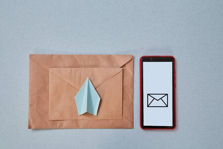 Email marketing and message online, online chat concept: Paper plane , envelope and smartphone