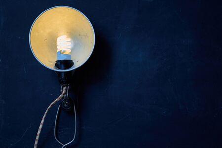 Vintage lamp on wooden background. Mock up. Blackboard. Copy space Reklamní fotografie