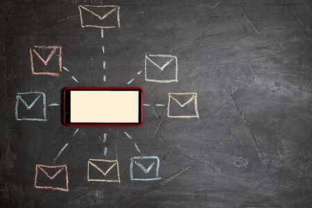 E-commerce and e-business. Email or sms marketing and mail communication message concept: Smartphone and mailbox symbols