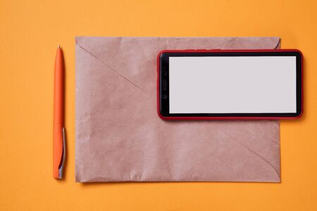 Email marketing and message online. Smartphone lying on the envelope. Background, mock up