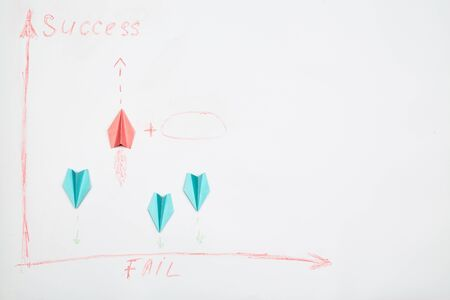 Business success and fail concept. Solution, rivalry and challenge. Colorful paper planes on a white background