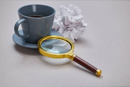 Education FAQ, analysis and SEO. Q and A or question and answer concept. Cup, magnifying glass and crumpled paper Reklamní fotografie