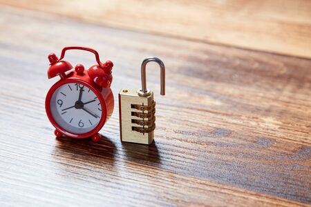 Time runnig out, deadline and time management concept. Red alarm clock and lock. Copy space