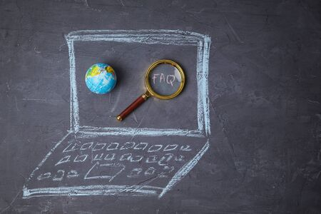 Internet or web search, FAQ, analysis and SEO concept. Drawn laptop, globe and magnifying glass