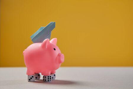 Earning, finance, investment, startup and stock market concept. Pink piggy, dice and rocket taking off Reklamní fotografie