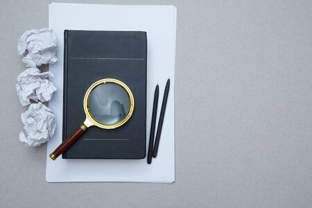 Magnifying glass, book and crumpled paper. FAQ, Q and A and SEO. Question, answer or analysis. Mockup, copy space
