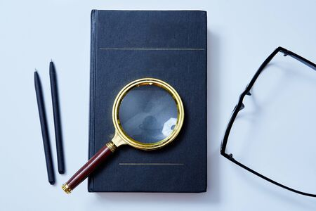 Magnifying glass on the book. Mockup, copy space. Analysis and analytic concept. Education, Question, answer concept.